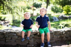 vibrant image of two little boys sitting on a rock wall in Newton MA