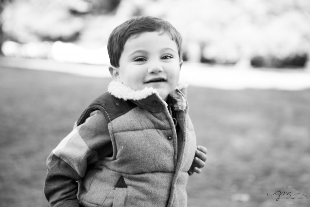 black and white image of smiling boy