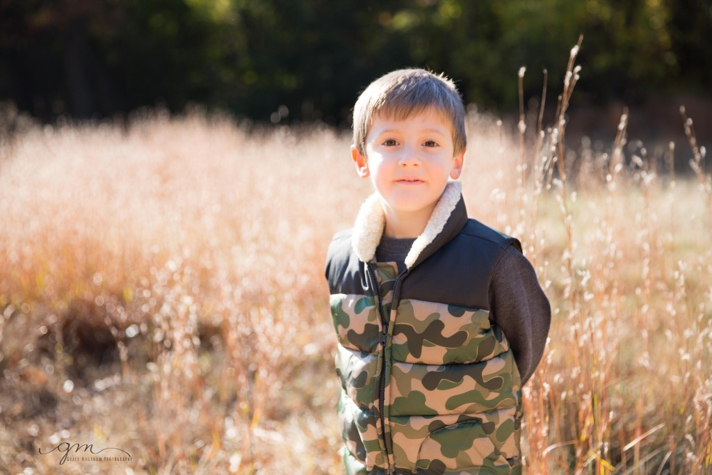 boy in light filled field