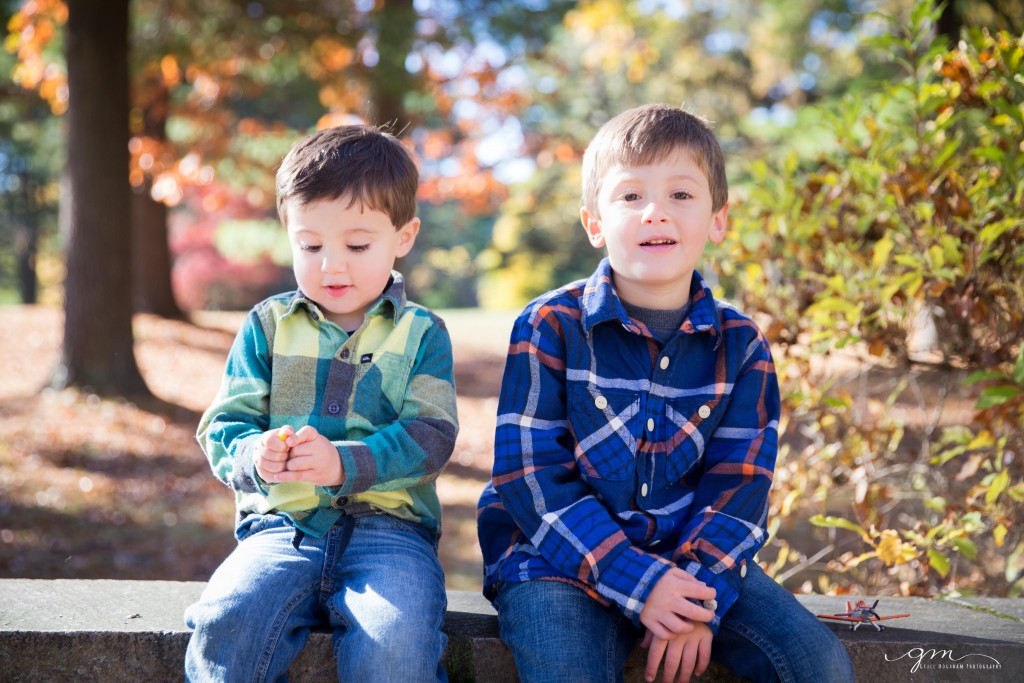 two brothers sitting on a wall